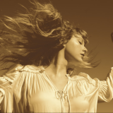 taylor swift as the cover on her re recorded album Fearless Taylor's version she is wearing a white blouse and her head is turned to viewer's right and her hair is flowing with the movement